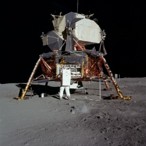 Buzz Aldrin right outside the Lunar Module. Photo Credit: NASA. Licensed under  Public Domain via Wikimedia Commons