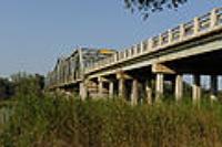 A suspension bridge over the Brazos River. Photo Credit: WikiMedia Commons (Public Domain).