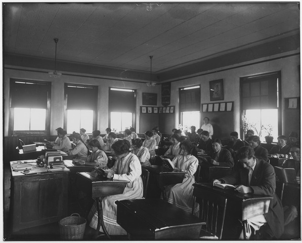 In this turn-of-the-century classroom, the students are reading books. Whole books, from cover to cover. How many children do you know who engage in that pursuit? Photo via  WikiMedia Commons .