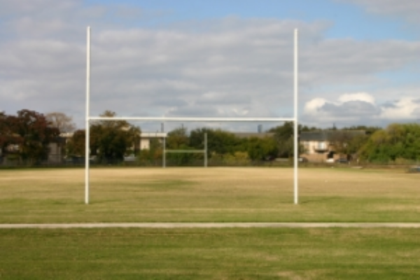 The football field at Garner Middle School has not changed much since my short, undistinguished career. Photo Credit: Steve Howen.