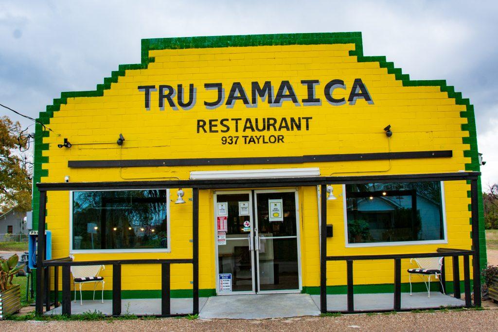 Tru Jamaica restaurant displays it East Waco roots through the use of Ira Watkins' murals.